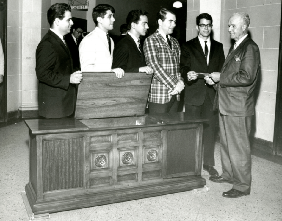 Dr. Howard W. Jones receiving a gift from Student Council